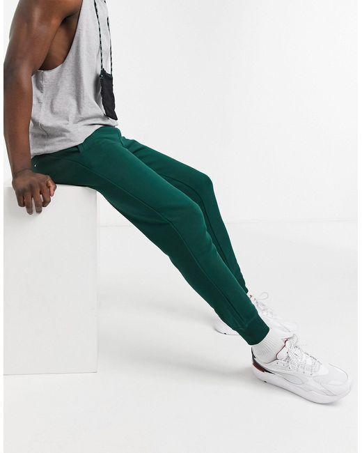 Зеленые Джоггеры С Манжетами И Логотипом -зеленый Цвет Tommy Hilfiger для него, цвет: Green