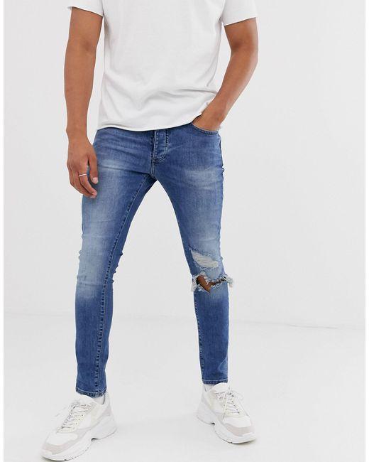 Jeans skinny blu con strappi di Mennace in Blue da Uomo