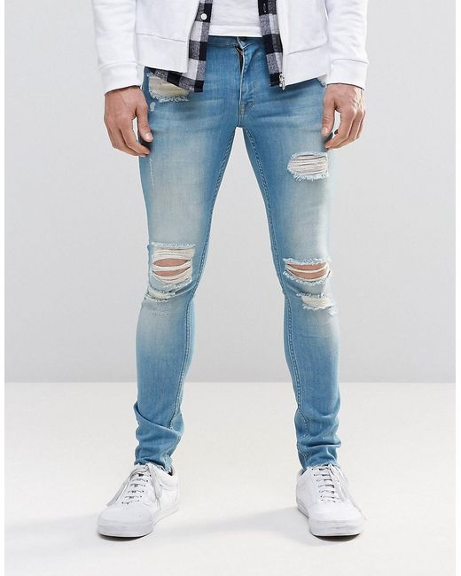 Asos extreme super skinny jeans with mega rips in mid blue for Zerissene jeans herren