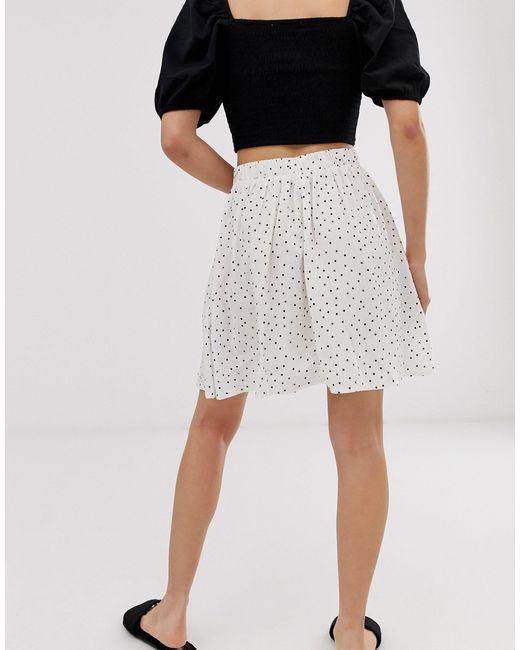 Minigonna a pois con bottoni bianca di New Look in Black