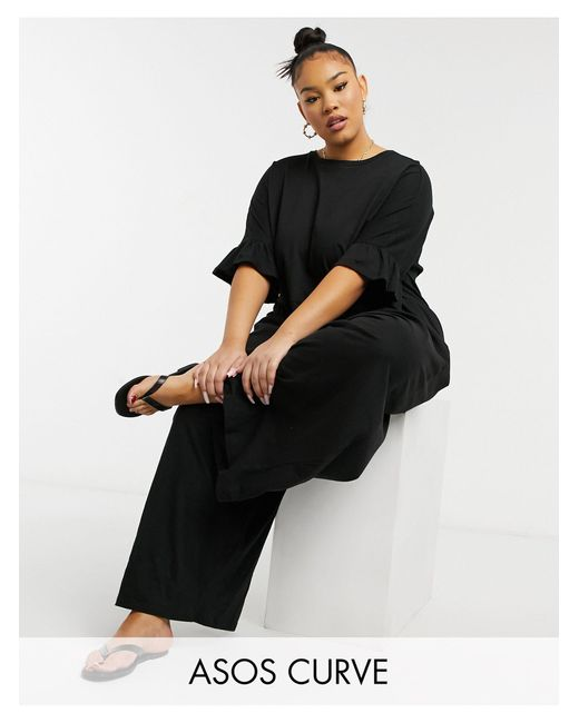 ASOS DESIGN Curve - Tuta jumpsuit grembiule di ASOS in Black
