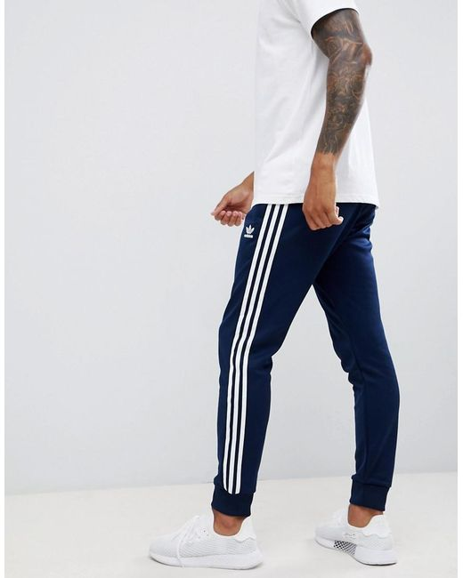 3-stripe Skinny Sweatpants With Cuffed Hem In Navy Dh5834