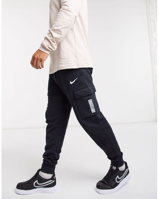 Nike Black Swoosh On Tour Pack Cuffed Cargo joggers for men