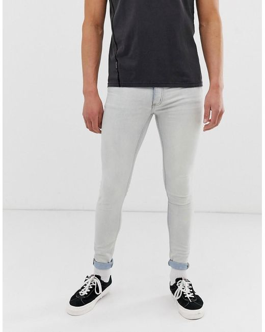 Cheap Monday Him Spray Super Skinny Jeans In Bleach Blue for men