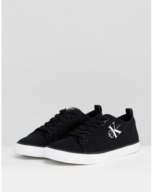 00f768bd1bb ... Calvin Klein - Arnold Logo Low Top Plimsolls In Black for Men - Lyst