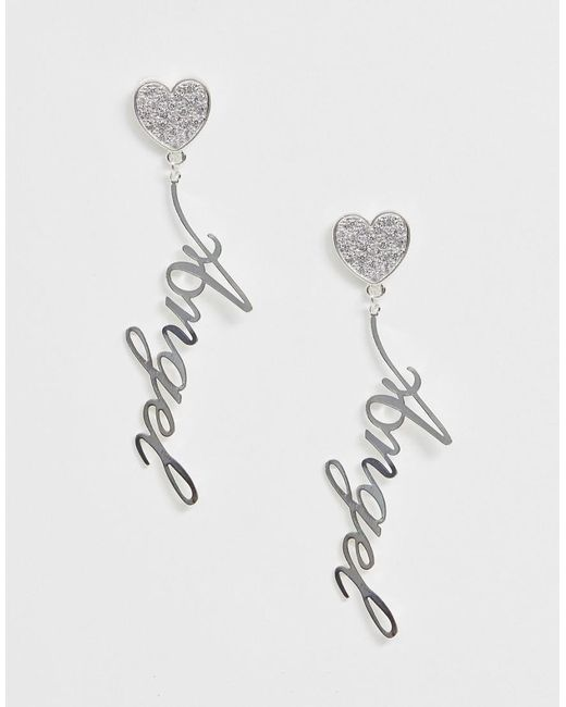 ASOS Metallic Earrings With Crystal Heart And Angel Slogan Drop In Silver Tone