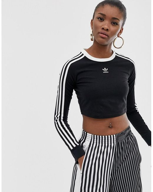 245f000f5 Adidas Originals - Three Stripe Cropped Long Sleeve Top In Black - Lyst ...