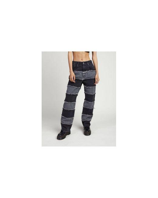 Jeans a vita alta con righe di jeans effetto patchwork di The Ragged Priest in Black