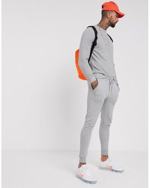 venta caliente online 52765 737a7 Chándal gris de canalé de hombre