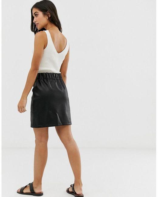 92364dc65f28d5 Mini-jupe tulipe texturée en similicuir femme de coloris noir