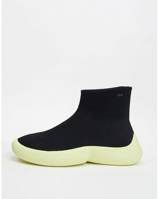 Camper Zapatillas tipo calcetín negras con suela amarilla de hombre de color negro