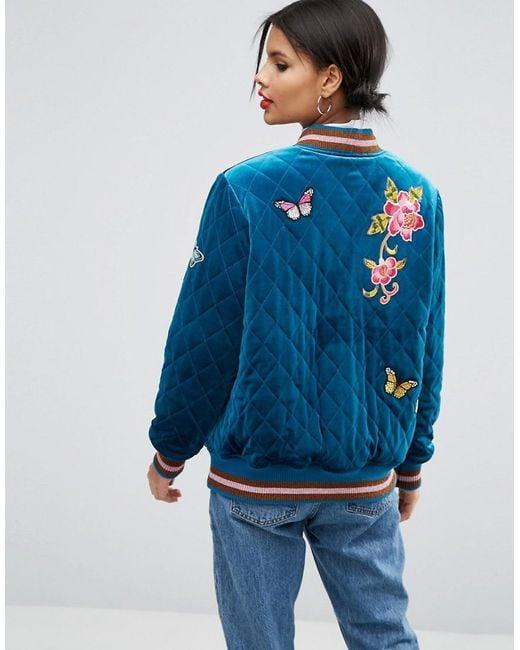 Asos Bomber Jacket In Velvet Quilt With Embroidered Badges