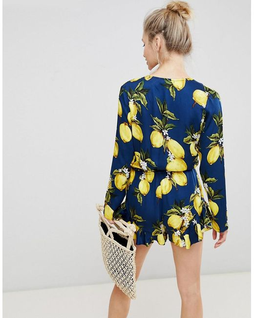 1cf0c05790 ... Glamorous - Blue Playsuit With Frill Shorts And Bow Front In Lemon  Print - Lyst