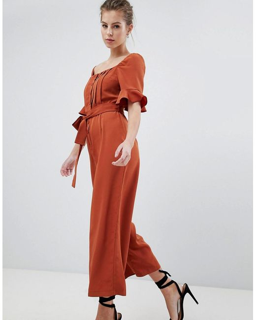 Jumpsuit by ASOS DESIGN, Done in one, All-over floral print, Break out the blooms, Plunge neck, Lace inserts, It's all in the details, Wide-cut leg, Regular fit - true to size.