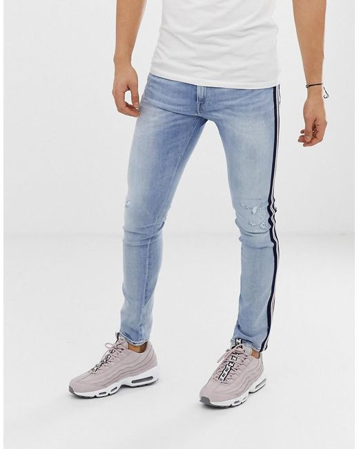 becabb760fc ... Replay - Blue Andov Ripped Power Stretch Skinny Jean With Side Stripe  In Light Wash for