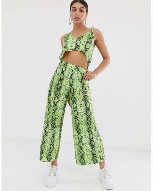 4528a72822 ASOS - Green Strappy Jumpsuit With Cut Out In Snake - Lyst ...
