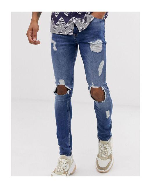 Jean super skinny avec grandes déchirures - délavé moyen ASOS pour homme en coloris Blue