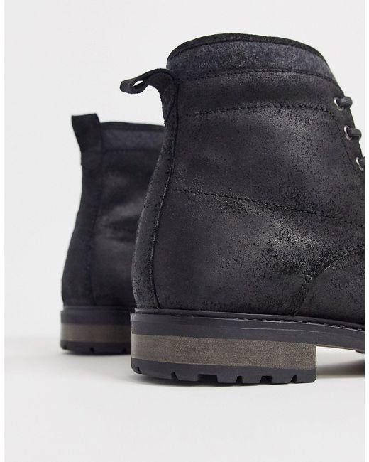 Botas de trabajo de cuero negro con cordones y forro de borreguito sintético de ASOS de hombre de color Black