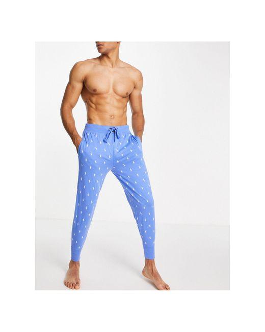 Голубые Джоггеры Со Сплошным Фирменным Принтом -голубой Polo Ralph Lauren для него, цвет: Blue