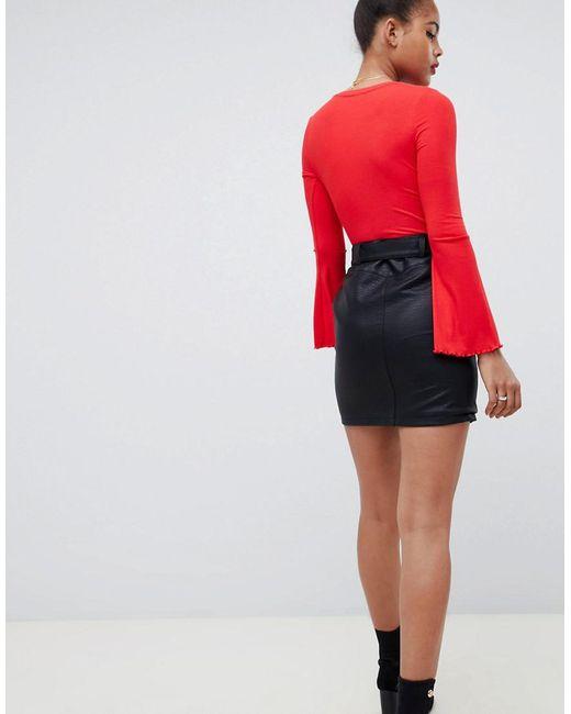 4b48cef3008e42 Mini-jupe en similicuir avec poches zippées et boutons-pression femme de  coloris noir