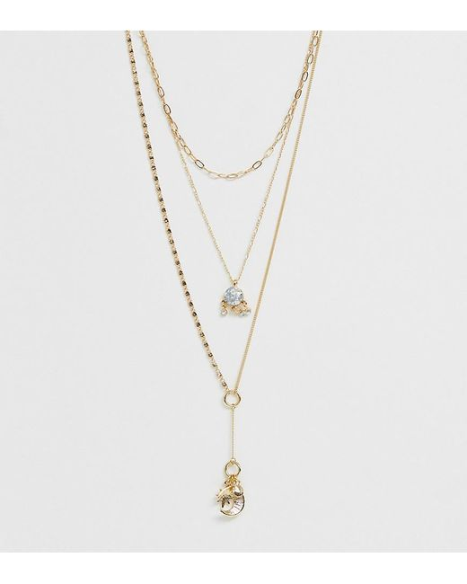 ASOS Metallic Asos Design Curve Multirow Necklace With Celestial Charms And Delicate Lariat Profile In Gold