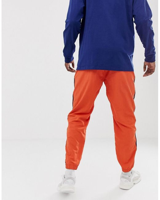 7a489bfd6cc3d5 ... Adidas Originals - Jogginghose in Orange mit 3-Streifendesign for Men -  Lyst