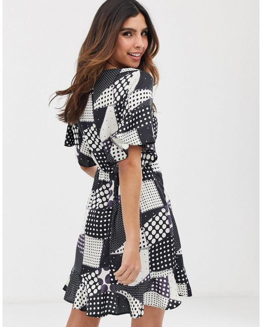 Robe cache-cœur courte à pois AX Paris en coloris Black