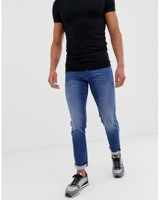 buy popular good out x on feet shots of Armani Exchange Denim J14 Skinny Fit Light Wash Jeans in Blue for ...