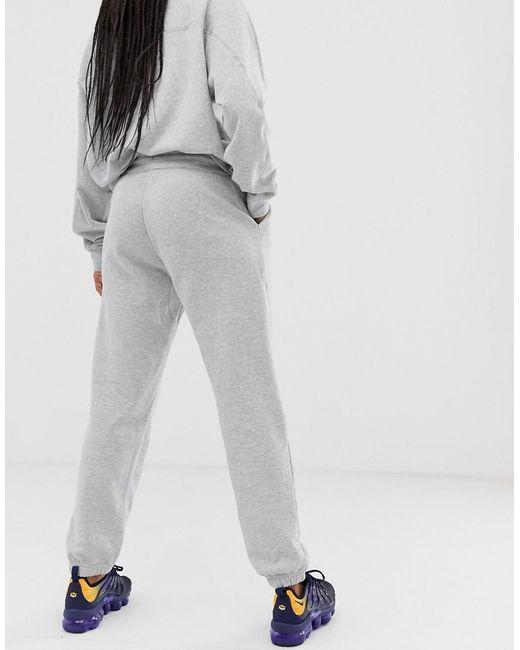 Nike – Jogginghose in Orange, exklusiv bei ASOS
