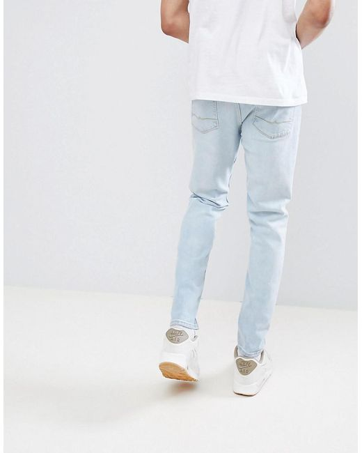 Cheap Official TALL Tapered Jeans In Light Wash Blue With Abrasions - Light wash blue Asos Discount Clearance bguMNRiwm