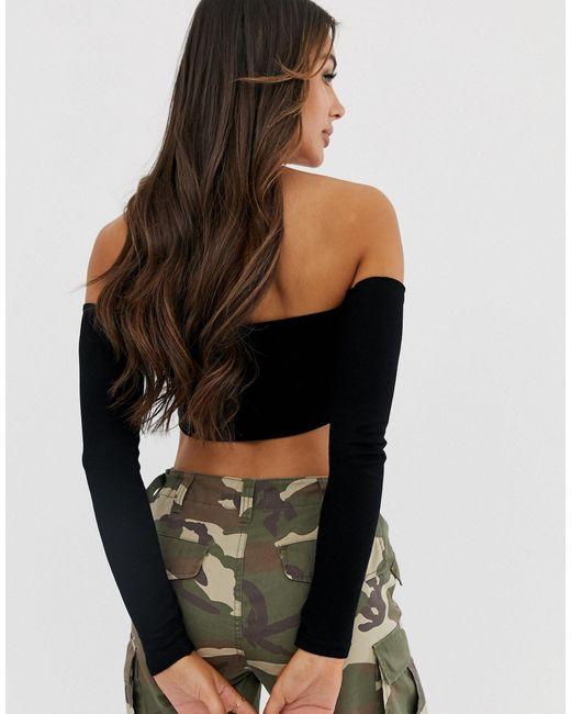 Top super court côtelé manches longue à épaules dénudées ASOS en coloris Black