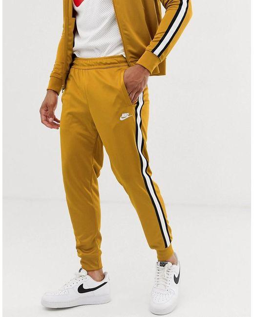 Buoni prezzi cerca il più recente negozio del Regno Unito Tribute - Pantaloni della tuta oro con logoNike in Cotone da Uomo ...