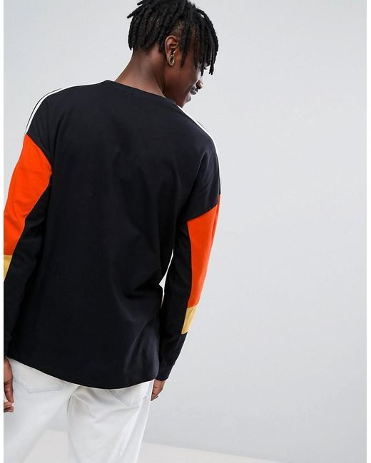 Top Quality Online Cost Cheap Online Oversized Long Sleeve T-Shirt With Bright Colour Blocking And Monochrome Taping - Black Asos Big Discount Cheap Price Buy Cheap Genuine LyYLEftQ1