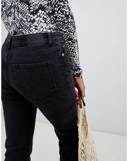 Jeans dritti slim a vita medio alta di Weekday in Black