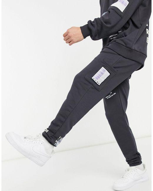 Темно-серые Свободные Джоггеры С Принтом -серый The Couture Club для него, цвет: Gray