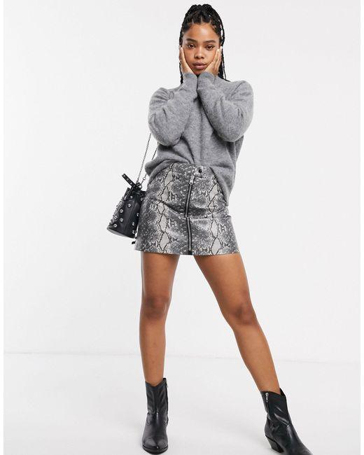 Minifalda con cremallera delantera y estampado AllSaints de color Black