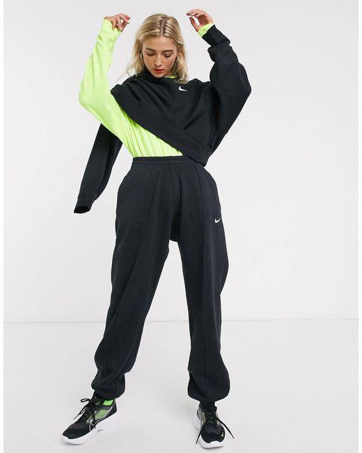 Joggers negros extragrandes con logo pequeño Nike de color Black