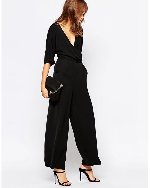 vero moda wrap front jumpsuit in black save 41 lyst. Black Bedroom Furniture Sets. Home Design Ideas