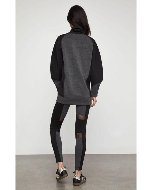 ba4217f3b2 ... BCBGMAXAZRIA - Black Bcbg Two-tone Knit Sweatshirt - Lyst ...