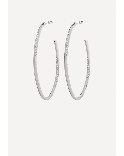 Bebe - Metallic Crystal Oval Hoop Earrings - Lyst