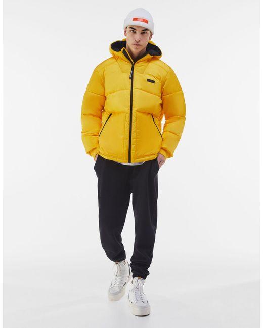 Cazadora Puffy Capucha Bershka de hombre de color Yellow