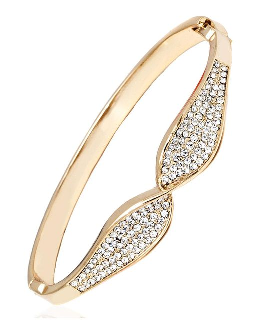 Peermont - Metallic Gold And White Swarovski Elements Bow Bangle - Lyst