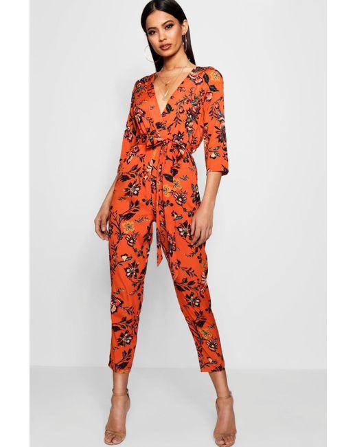 67075efe94f Boohoo - Orange Floral Wrap Front Jumpsuit - Lyst ...