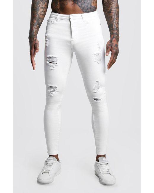 d0e152d4be754 Boohoo - White Spray On Skinny Distressed Denim Jeans for Men - Lyst ...