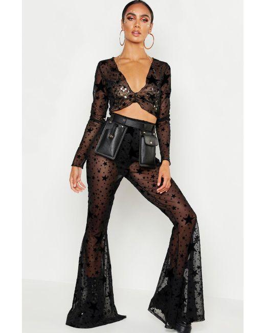 2e37bbf2b2dd Boohoo - Black Flock Mesh Star Print Flare Trouser - Lyst ...