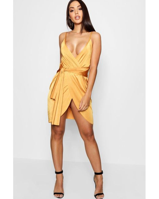 Boohoo - Yellow Wrap Belted Bodycon Dress - Lyst ... bcd9df312