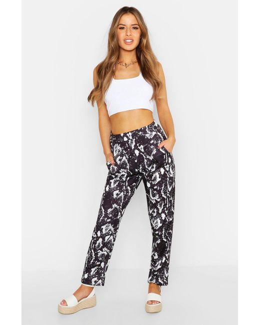 edeb7a273751 Boohoo Petite Snake Printed Tailored Trousers in Black - Lyst