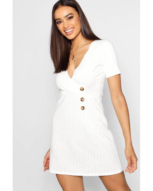 a50b20a3fb32 Boohoo - White Wrap Over Horn Button Rib Knit Swing Dress - Lyst ...