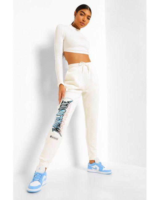 Pantalones De Deporte Con Estampado Worldwide Boohoo de color White