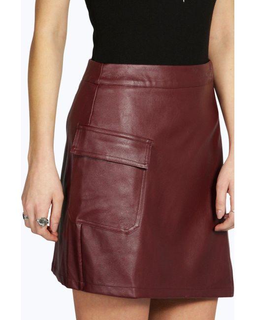 boohoo suri asymetric wrap leather look mini skirt in